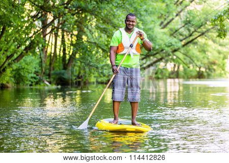 Man paddling a SUP on river