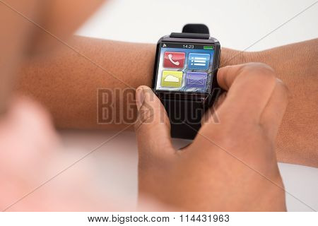 Person's Hand Wearing Smartwatch