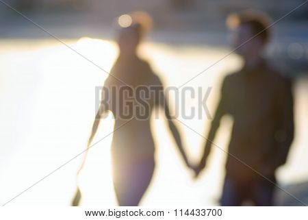 Blurred Silhouettes Of People