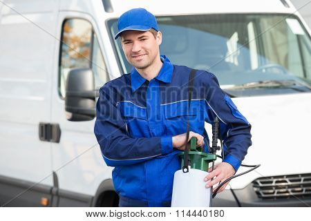 Pest Control Worker With Pesticide Against Truck