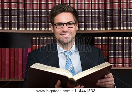 Advocate Reading Book At Courtroom