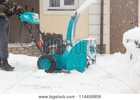 man with snowblower