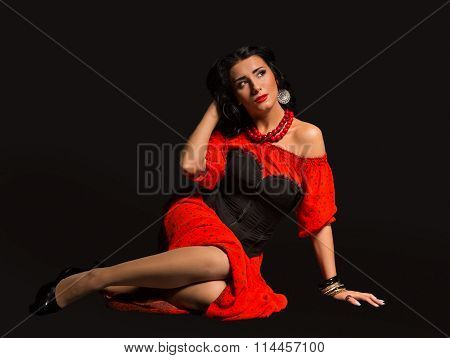 The image, chic, sexy Spaniard. Chic, sexy woman in a red dress