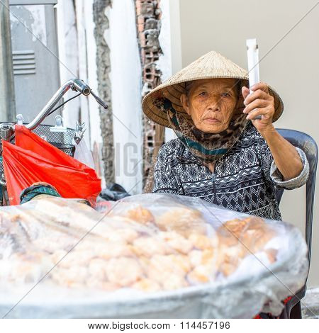 HO CHI MINH CITY, VIETNAM - JAN 11, 2016: Unidentified local woman street vendor. By the end of 2014, the city's GDP grew 9.5%, with GDP per capita reaching $5100.