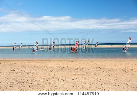 FUERTEVENTURA, SPAIN - SEPTEMBER 14, 2015: Windsurfing on the beach of Costa Calma .Fuerteventura Canary Island . Spain