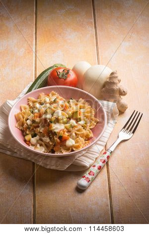 pasta with tomatoes zucchinis and scamorza cheese