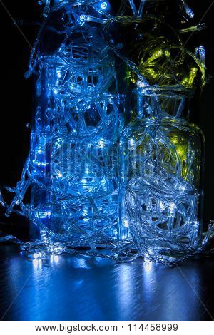Beautiful Christmas decorations. Glowing light bulb in the bottle