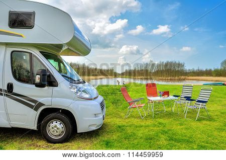 RV (camper) in camping, family vacation travel, holiday trip in motorhome