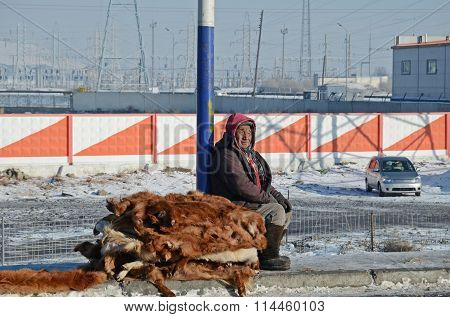 Ulaanbaatar, Mongolia - Dec, 03 2015: Man Sells Cowhides On The Side Of The Road In Mongolia