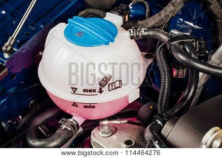 coolant antifreeze tank under engine hood
