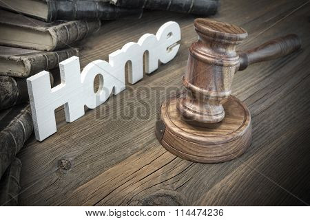 Sign Home,judges Gavel And Old Book On Wood Table