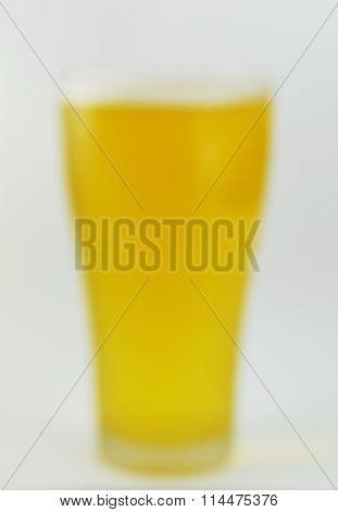 blurry glass of beer through drunken eye
