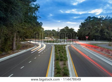 Traffic roundabout with light trails from cars