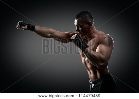 Fighter boxer on black background