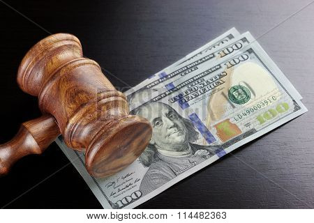 Judges Gavel And Dollar Cash  On The Black Table