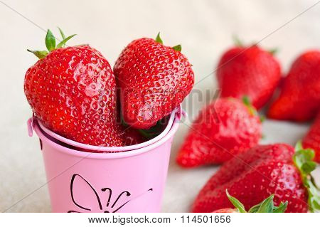 Strawberries In A Decorative Bucket