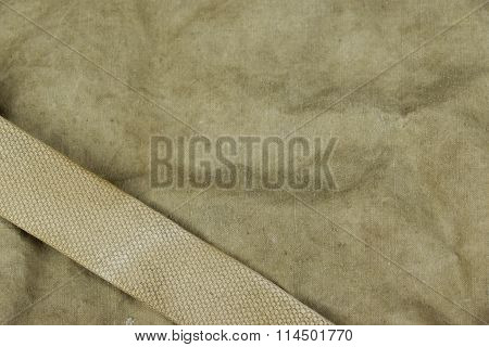 Weathered Faded Military Army  Khaki Camouflage With Belt. Background Texture