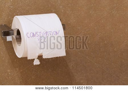 The Word Constipation Written On A Tolet Paper