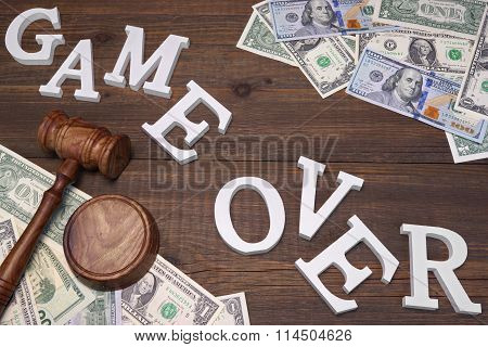 Sign Game Over, Doolars Cash, Judges Gavel On Wood Background
