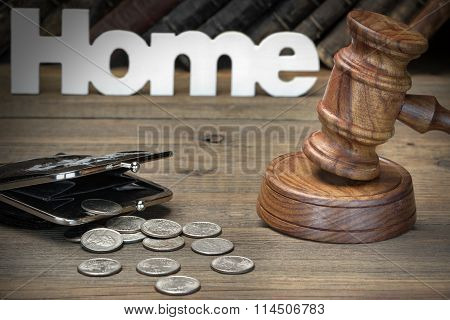 Sign Home, Gavel, Purse And Old Book On Wood Table