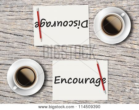 Business Concept : Comparison Between Discourage And Encourage