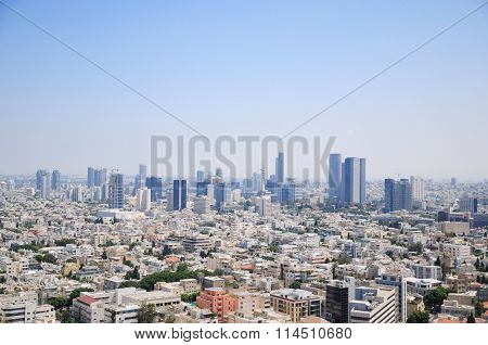 Aerial view of Tel Aviv skyline with its skyscrapers on a clear blue sky (east view from Kolbo Shalo