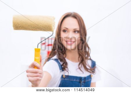 Girl in male role is busy painting.