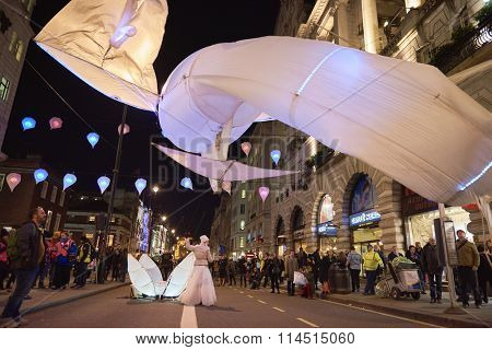 LONDON, UK - JANUARY 14: Les Lumin�©oles installation by art group Port�© par le vent. The fish-like illuminated kites are part of the Lumiere London. January 14, 2016 in London.