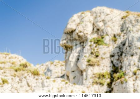 Defocused Background With Anthropomorphic Rock In Milazzo, Italy