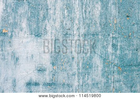 Grunge light blue painted wooden textured background.