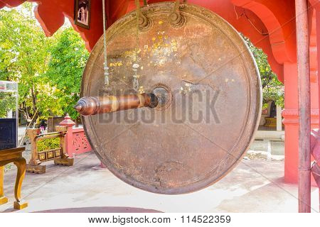 large gong at a Buddhist temple Thailand . poster