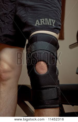 Knee brace on soldier wearing PT shorts