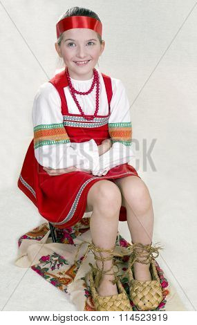 Russian girl in  national clothes and the big bast shoes