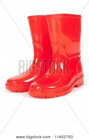 A Pair Of Red Rainboots On A White Background