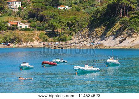 Anchored Motorboats In Waters Of Tyrrhenian Sea, Sant Andreas On Elba Island, Italy