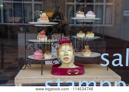 Plates With Small Cakes In The Window Of The Confectionery Shop In Haarlem, The Netherlands