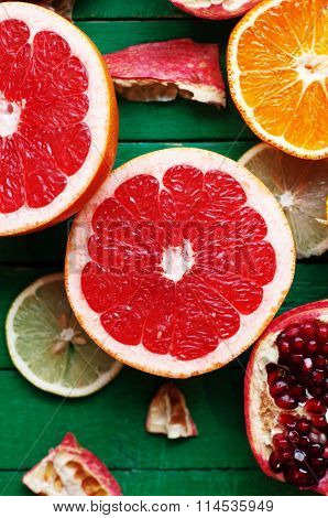 Fruit in a cut closeup, grapefruit, orange, lemon, tangerine, fruit background. rustic food. fruit.