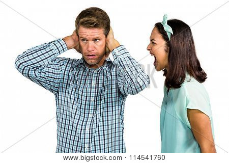 Couple arguing with each other against against white background