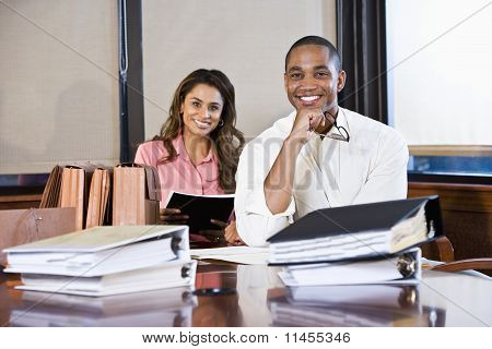 Multiracial Businesspeople Working On Documents
