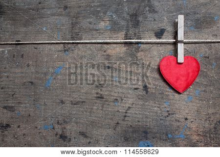Greeting card with red heart on wooden surface