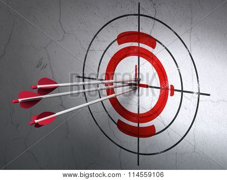 Time concept: arrows in Watch target on wall background