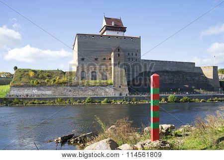 Russian border post on the background of the Narva and the castle Herman