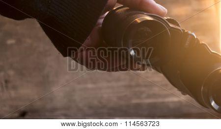 Vision word on binoculars. Sunset.