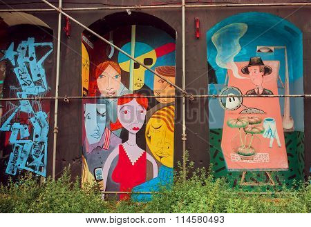 Weird People On Colorful Mural In Artistic Area With Graffiti
