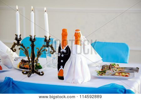 Wedding table with dishes and bottles.