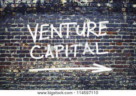 Venture Capital Text On Brick Wall