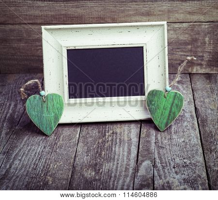 Two Wooden Hearts And Blackboard