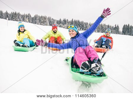 Friends Riding Sleds