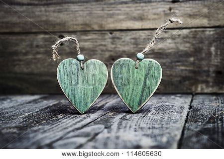 Green Wooden Hearts On Board