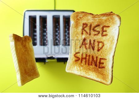 Good morning rise and shine on flying toast or toasted bread popping up from the toaster